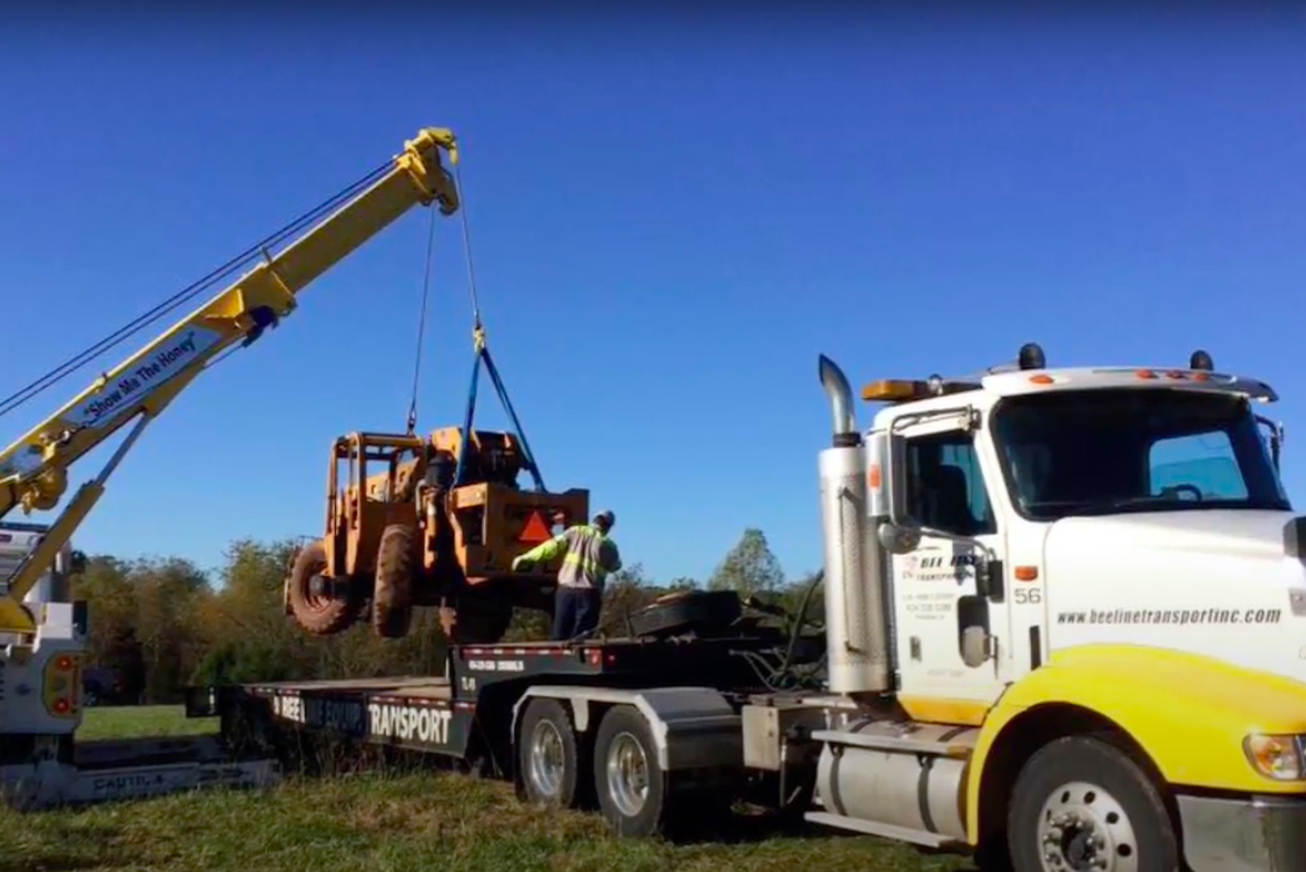Heavy Towing of Construction Equipment on a Flatbed