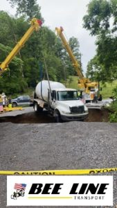 Truck falls through the asphalt. Towing Company comes to the rescue
