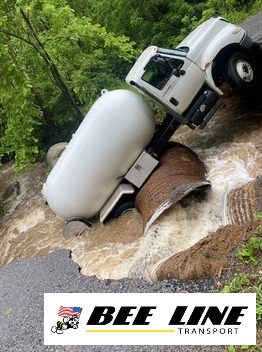 Towing company overcomes caved-in and flooded roads to rescue propane truck in Blue Ridge VA